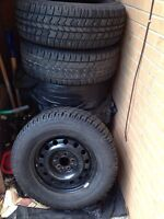4 Arctic Claw winter tires with rims: 235/70R16 (NEGO)