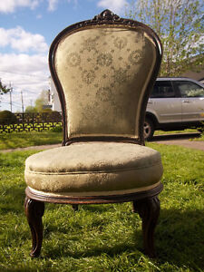 Beautiful Antique Chair with carvings, and castor wheels