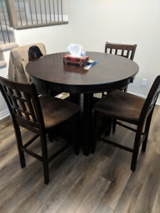 Dining table bar height with 4 chairs and leaf.