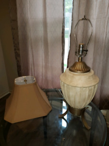 Lamp without shade and extra lamp shade
