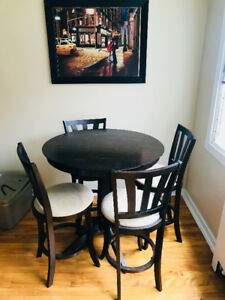 Beautiful high oak dinning table with four stool type of chairs