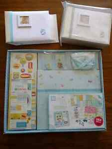 Baby boy scrapbook album and 2 picture albums