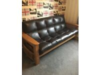 Solid oak and leather bed settee and matching chair
