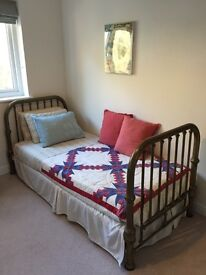 Antique single brass bed. Mattress and two sets of linens included Super comfy!