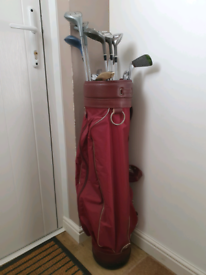 Ladies set of golf clubs with bag.