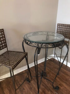 Pier 1 glass table and two solid chairs- pub height