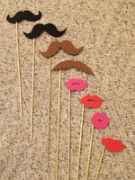 Lips and moustaches on a stick!