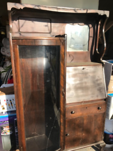 Vintage side by side curio cabinet with small writing area,