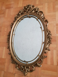 Vintage ornate gold oval Syroco Mirror