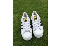 Adidas originals (black & white) superstars, size 5