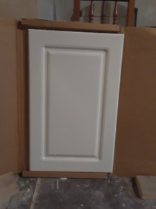 2 new white  cabinet doors still in packaging.