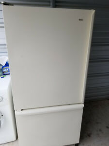 Whirlpool Manufactured Fridge and Stove off white colour