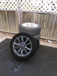 Ford aluminum rims with tires