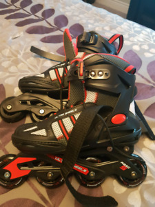 Size 7 Roller Blades. New. Never worn.