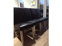 Four faux leather dining chairs for sale