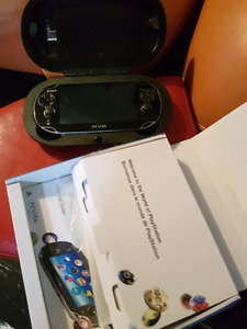 PS VITA WITH 6 GAMES AND SPECIAL PROTECTIVE CASE AND 4gb sd card