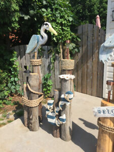 Nautical post with pelicans, anchors, rope and lights