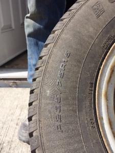 winter tires 235x75x15 on rims $300