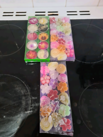 New assorted candles and decorative pebbles