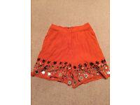 ASOS orange sparkly hem shorts