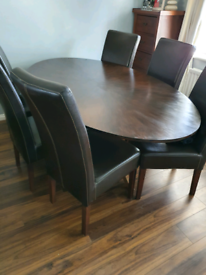 Oak dining table and 6 chairs for sale