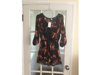 Navy flower H & M play suit size 10 new