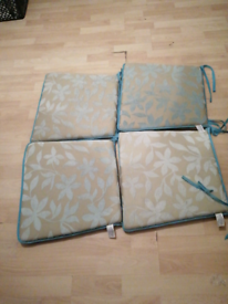 For sale 4 chair covers in teal ties to use nice and clean I washed th