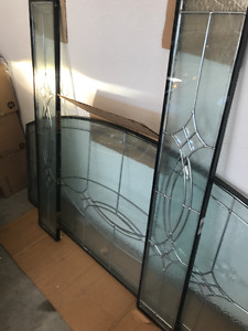 Beveled stain glass window arch and two side panels