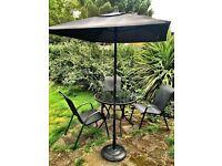 Granite black garden table, umbrella and 4 chairs