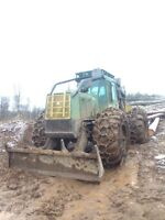 2000 Timberjack 660 grapple skidder with free delivery.