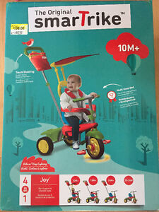 Tricycle Smartrike 4 in 1 (brand new never been opened)