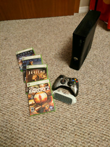 XBox 360 S with controller and four games