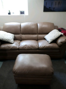 Bonded leather couch barely sat on