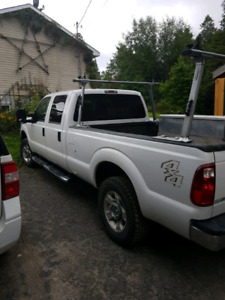 F250 4x4 8 foot box spray in liner ladder rack