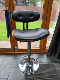 Two swivel bar chair