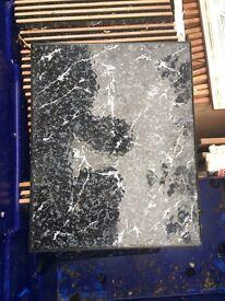 Black marble effect oblong tiles