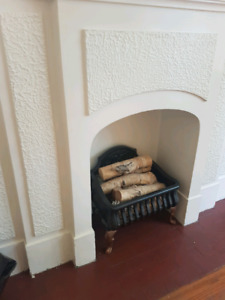 Cute little fireplace insert. Metal filled with birch wood
