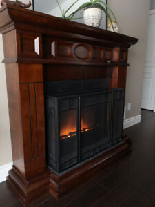 Electric fireplace in cherry TV stand