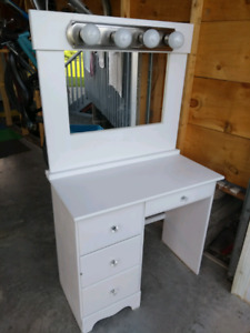 Vanity desk with mirror and light