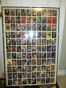 TOPPS 1994-95 NBA Uncut Cards in a back to back glass frame.