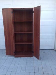 Cherry finish pantry with four shelves
