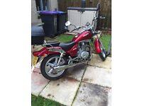 Red cruiser motorbike 125