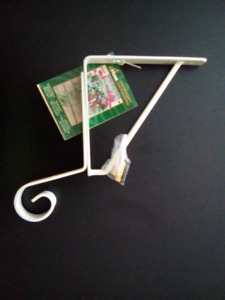 Adjustable wall mounted brackets for flower baskets or boxes
