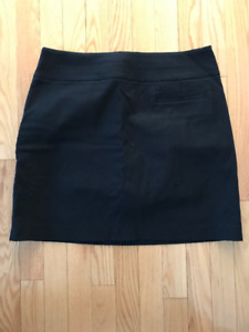 GREG NORMAN  GOLF SKORTS SIZE 10 NEW WITHOUT THE TAGS