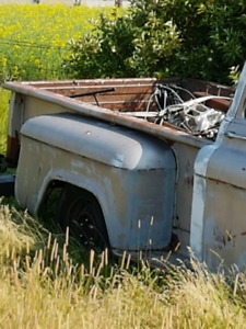 Old gutted out Chevy 57 truck...has wheels etc