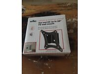 "flat and tilt up to 23"" tv wall mount still in box"