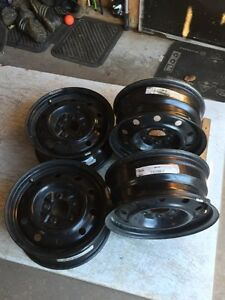 4 practically new 15 inch winter rims