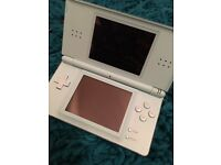 Nintendo DS lite, charger and games