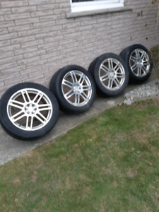 Cadillac 20 inch SRX rims and tires