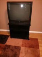 """27"""" RCA television with remote and TV stand"""